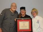 Dennis Nosko and Christine Robinson Accept Chef of the Year Award from Candy Wallace