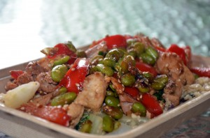 """Chicken Edamame Stir Fry served over """"Riced"""" Cauliflower. """"I use cauliflower to take the place of heavy, carb-laden rice."""""""